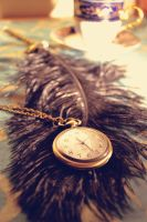 black feather+clock by MaithaNeyadi