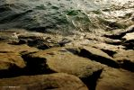 Repeated wave on rock n sea by sarthahirah