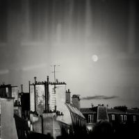 The moon above Paris by burzinski