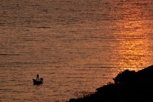 fisherman at sunrise by torobala