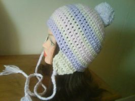 Striped pom pom hat by MinaThomas