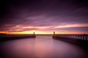 Whitby Harbour at Sunset by kharashov