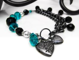 Teal and Black Charm Bracelet by pila12903