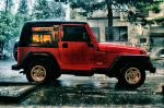 Jeep wrangler in rain by Chipson