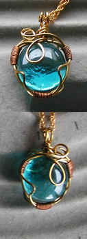 Blue wire wrap pendant by twig7998