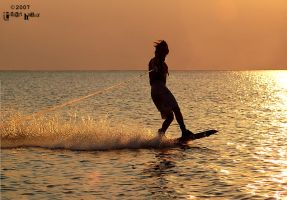 Wakeboarding at sunset.. by timmethegreat
