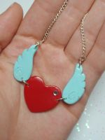 Heart and wings necklace by voodoogrl