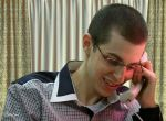 Gilad Shalit on phone with his parents by Lior-Art