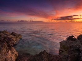 Coral sea sunset by peterpateman
