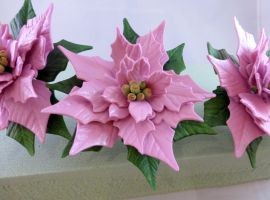 Pink gumpaste poinsettia by GoodnessCakes