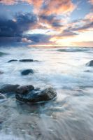 Sunset with a ROCK by Laurman
