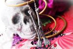 Silver Glitter Skeleton Leg Bone Earrings by Cateaclysmic