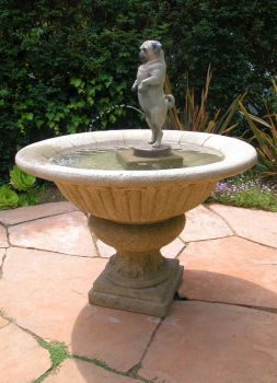Peeing pug fountain by MarkNewman