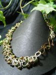 Green And Bronze Shaggy Loops With Fancy Clasp by BacktoEarthCreations