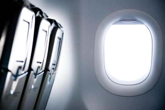Airplane window by GlueR