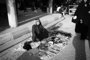 Old man selling scarfs by Anmar-Studio
