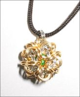 Gold and Silver Ball Pendant by immortaldesigns