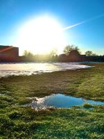 Extreme Sunset Over a Puddle by Insaniac1126